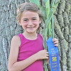 "TOP STALK<br /> Elizabeth Pearl | The Lebanon Reporter<br /> CORNSTALK WINNER: Isabella Forrester took home the prize for tallest cornstalk Wednesday at the Boone County 4-H Fair. Forrester's stalk was 152.125 inches tall. Nick Starkey came in second with a 151.25 inch stalk, and Grayson Forrester, Isabella Forrester's brother, came in third with a 149 inch stalk. Cassandra Forrester, Isabella and Grayson's mom, said that it was the first time her children had entered the competition. They got their stalks from Joe Stefanik, a neighbor. ""We were invited to come snatch a stalk and we did,"" Cassandra Forrester said. Sixteen people entered the tallest cornstalk competition this year."