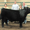 Rod Rose The Lebanon Reporter<br /> GRAND CHAMPION STEER: Joined by family and judge Justin Jensen, Nola Dickerson stands with her grand champion steer at the Boone County 4-H Fair beef show Saturday.