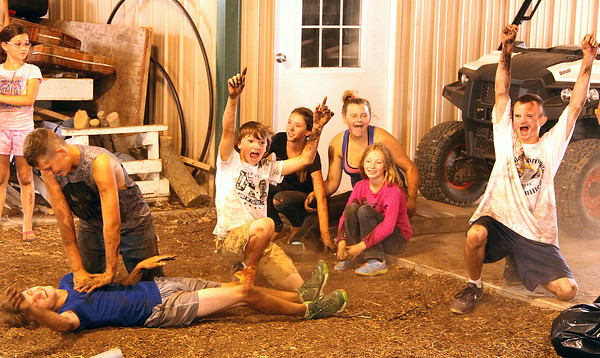 Celebration Time: Llama Barn participant Tim Gillihan (ground) and team (from left), Qwintin Ryan, Dillon Gillihan, Autumn Ryan, Loryn Patterson, Felicity Marshall, and Alex Gillihan celebrate their finals win during Thursday's Battle of the Barns over the Horse Barn. A penalty against the Horse Bar in the finals gave the Llama Barn a decided edge and path to victory. Thursday was the final day of the 2016 Boone County 4-H Fair.