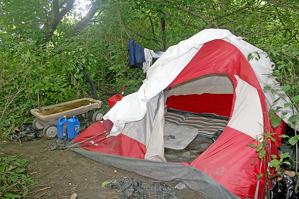 Rod Rose The Lebanon Reporter<br /> HOMELESS CAMP: One of several tents are pitched in and near a woods on Lebanon's west side, where police said homeless people have found temporary shelter.