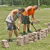 "LABRYNTHINE: Lebanon High School football players Logan Dickey (left) and Luke Terrill are part of a group helping to construct a labrynth for St. Peter's Episcopal Church. The group, which includes fellow football players Bryce Marshall, Elijah Allen and Trevor Boyne, worked all day Friday and will continue Sunday on the labrynth, which will be a place of meditation and prayer for community members, said church member Dana Halstead. <br /> <br /> Indianapolis resident John Ridder has helped construct labrynths all over the world with his group, Paxworks. Unlike mazes, labrynths are designed so that a person can walk the entire course without searching for a way out. <br /> ""The beauty of it is that anyone can approach on their own terms,"" Ridder said. ""You don't have to believe in any religious dogma to walk it."""