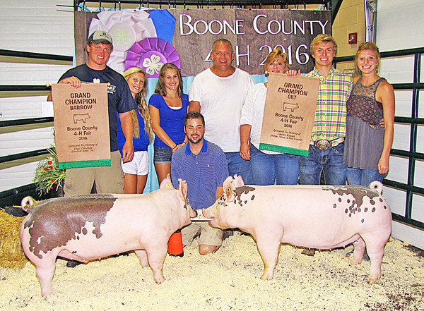 Rod Rose The Lebanon Reporter<br /> SWINE SHOW SWEEP: Ryan Solomon (second from right) is joined by (from left) Ray Solomon, Savannah Bealmer, Madie Bright, Rusty Solomon, Jody Solomon and Sara Solomon after he exhibited the grand champion barrow and grand champion gilt at Tuesday's Boone County 4-H Fair swine show.