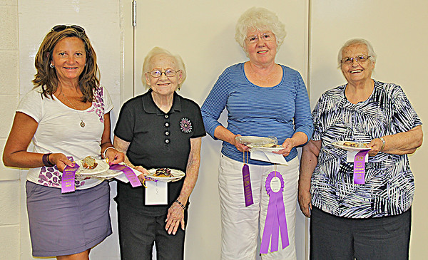 "PIE IN THE SKY <br /> Elizabeth Pearl | The Lebanon Reporter <br /> CREATIVE COOKERY WINNERS: For the second year in a row, Kathy Budreau was named overall champion of the Boone County 4-H Fair Extension Homemakers Creative Cookery contest. Using this year's theme of grapes, Budreau made a concord grape pie with strudel topping. Shown above are the contest winners, from left: Becky Cheetham (dessert and muffins), Barbara McPeake (cake), Kathy Budreau (overall, pie, candy), and Margery Reeves (cookies). Budreau said that the grape pie she brought to the contest was the first one she ever made. ""I'm a mad scientist in the kitchen,"" she said. Judge Karen Lackey said that the pie was chosen because of the great flavor of the grapes and its excellence overall. When judging a flavor-themed contest the most important factor is the incorporation of that theme, and Budreau's pie represented the grape theme best. ""It had such an intense grape flavor,"" Lackey said. ""It was beautifully done and had great eye appeal. It was overall a fantastic pie."""