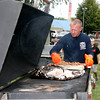 Rod Rose The Lebanon Reporter<br /> BARBECUE SMOKER: Lebanon Fire Department firefighter Brett Klingler tends to the smoker at Saturday's hog roast, sponsored by the Lebanon Fire Department Auxiliary, at the main shelter house in Lebanon's Memorial Park. A steady flow of diners attended the event, which ran from 5 to 8 p.m.