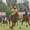 HORSING AROUND: Players aim to shoot in the third chukker at Saturday's event.