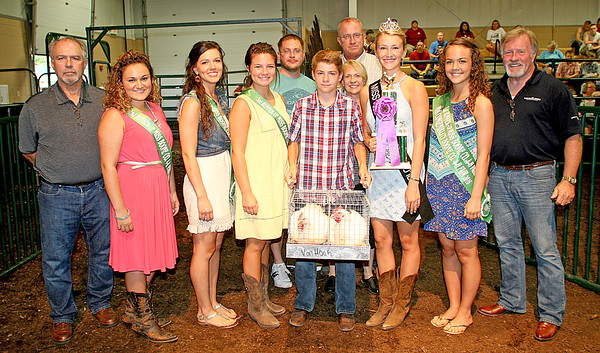 Rod Rose The Lebanon Reporter<br /> BEST BIRDS: Benton Foxworthy, surrounded by the queen's court and buyers, holds his grand champion poultry commercial meat birds after receiving $600 at Thursday night's Boone County 4-H Fair's livestock auction. Buyers were Alex Kruse, Boone County Lodge No. 9 F. & A.M., Parr, Richey, Obremskey, Frandsen and Patterson, Paul Kruse and Lamar & Lamar Insurance.