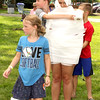 Egyptian Challenge: Autumn Jones (front), 7, along with Sarah Keith, 10, and Chase Tucker (back), 10, wrap Boone County 4-H Fair Queen's Court second runner-up Emma Mendez intoilet paper during Tuesday's Family Day festivities.