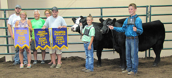 Rod Rose The Lebanon Reporter<br /> BEEF SHOW SWEEP: Kaden Bennington (second from right) exhibited the grand champion, reserve grand champion and Boone County born and raise grand champion heifers at Saturday's Boone County 4-H Fair beef show. With him are (from left) A.J. Stockdale, Laine Bennington, Teddy Bennington, Delana Bennington, Austin Bennington and Austin Bush.