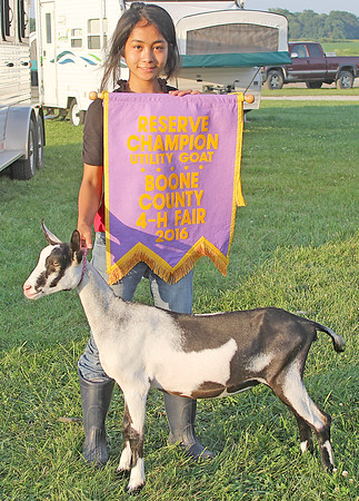 RESERVE CHAMPION: Cannery Snapp was the reserve grand champion in the Boone County 4-H Fair Utility Goat Show. She is pictured here with her goat Adaira.