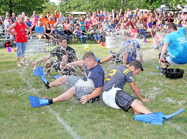 Rod Rose The Lebanon Reporter<br /> SPLASHDOWN: Contestants from the Buffalo Wild Wings and Lebanon Police Department teams battle for an ice-filled bucket -- while clad in adult diapers -- during the first event at the Adult Almost Anything Goes contest held Thursday evening at Lebanon's Memorial Park. In a tight contest, the Lebanon Fire Department team of Jon and Lindsey Bankert, Noah and Brooke Rincker, Jacob and Courtney Fussell and Alex Knipp edged the Lebanon police team. The Freedom Church squad placed third.