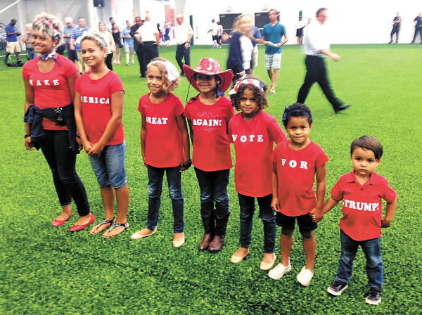 Stu Hirsch | The Herald Bulletin<br /> Members of the Payne family of Lebanon, Ind., line up to give their message of support for presumptive Republican presidential nominee Donald Trump with their T-shirts.