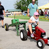 Almost There: Claire Wilhoite won the 4 and 5 age division of the tractor pull during Tuesday's Family Day at the Boone County 4-H Fair. Wilhoite, flanked by judges Kaleb Brinkman (left) and Adam Beck, tallied a full pull in the first round and won with a pull of 29 feet. Cooper Revell won the 6 to 7 division  with a full pull. Haylee Holloman took first in the 8 to 9 class, following her fullpull with a distance of 37 feet. 33 kids participated in the event.