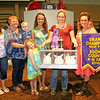 Rod Rose The Lebanon Reporter<br /> RABBIT ROYALTY: Holly Foxworthy is joined by members of the queen's court, family and buyer representatives after the Boone County Extension Homemakers paid $900 for her grand champion rabbit meat pen at the Boone County 4-H Fair livestock auction.