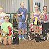 TOP FOURTEEN: The 4-Hers with the highest overall scores at the Dog Show were, from left, Emerson Haines, Nate Williams, Olivia Williams, Shelby Woodruff, Carlie Pennington, Logan Wallace, Dori Banner, Bailey Neese, Abbie Battisti, Abbey Haywood and Zane Williams. Not pictured are Ellia Aguayo, Taylor Neese and Sophie Martinez. The highest overall scores include obedience, showmanship, poster, dog knowledge and benching scores.