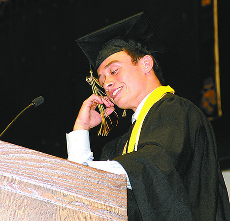 Lebanon High School valedictorian Collin Campbell emphasizes a joke during his speech at commencement Friday.