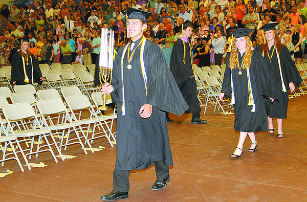 Lebanon High School Senior Class President Cameron Hudson lerads the candelabrum committee to the podium during graduation ceremonies Friday.