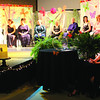 Reporter photo by Marda Johnson<br /> Mrs. Boone All: Nine Boone County women vying for the title of 2013 Mrs. Boone County sit together on stage at Freedom Church in Lebanon during the 2013 Mrs. Boone County pageant Saturday evening.Jennifer Sherrill, Mrs. Boone County and Mrs. Congeniality 2012, is shown in the foreground, at right.