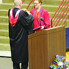 Western Boone Principal Rob Ramey drapes the valedictorian medal around the neck of Wilda Knecht Saturday, as Knecht approached the podium to receive the medal and address her classmates during the school's graduation Saturday.