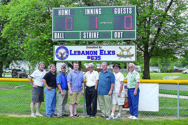 Elks members, from left, Rick Ellis, Jerry Bowen, Derek Brandt, Lee Ellis, Jerry Breedlove, Walter Burtner, Kevin VanHorn, and Charles Bradley were at the Lebanon Little League scoreboard dedication Wednesday evening.