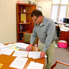 Wayne DeLong, director of planning and economic development, looks through documents Wednesday morning, June 12, in his office at Town Hall. DeLong has seen a lot of change throughout the town and department in the year that he has been in his role.