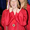 Rod Rose The Lebanon Reporter<br /> Lisa Spear gives a thumbs up to friends and family as she enters the Western Boone gymnasium for graduation ceremonies Saturday morning.