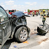 The driver of the GMC Yukon at left was taken to Hendricks Regional Health, Danville, after a crash Thursday afternoon at Indiana 267 and Indianapolis Road killed one occupant of the inverted Chevrolet Suburban in background, and critically injured another.