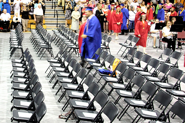 Rod Rose The Lebanon Reporter<br /> A T-shirt, rose and other items were placed on a chair that would have been occupied by Jake Shockley, who died in an auto accident earlier this year, at Western Boone High School's graduation ceremony Saturday morning.