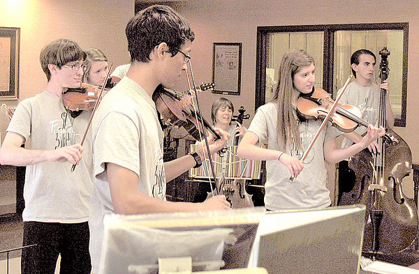 "Members of Fiddlesticks perform ""A Random Act of Culture"" in the lobby of The Lebanon Reporter Friday morning."