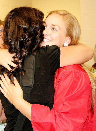 Rod Rose The Lebanon Reporter<br /> Loren Marsh hugs (right) hugs Shelly Miller during Western Boone High School's annual senior walk Friday afternoon. Western Boone's class of 2014 graduated in ceremonies at the school today.
