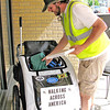 Rod Rose The Lebanon Reporter<br /> Kenyon Eastin packs his cart before leaving downtown Lebanon on his eventual way to the Pacific Ocean.