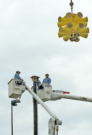 Photo submitted<br /> Lebanon Utility linemen helped install a tornado siren, shown being lifted into position, on Cox Avenue in Lebanon Friday. Lebanon Fire Chief Chuck Batts said Adams Electric helped with the installation.
