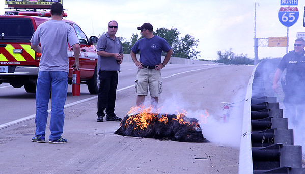 Fire Breaks Out On Interstate<br /> By Jake Thompson | The Lebanon Reporter<br /> Small Fire: Emergency responders stand around a burning bale of hay that had caught fire after falling from a truck near the 140.6 mile marker of I-65 north. Lebanon Fire Department's Engine 11 responded to the scene, and doused the flames quickly. Traffic was able to move freely very soon after the incident.