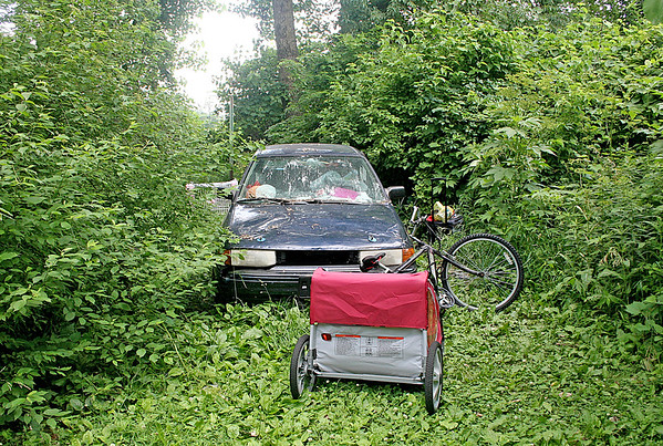 Rod Rose The Lebanon Reporter<br /> HOMELESS CAMP: This Ford Escort LX, backed into brush in a woods north of the Kentucky Fried Chicken restaurant on Lebanon's west side, was where a woman was living when she was stabbed in an apparent argument over food.