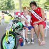 Rod Rose The Lebanon Reporter<br /> LITTLE BOY BOONE: Lane Michael Rose, crowned Little Boy Boone Saturday, sits with Mrs. Boone County Kim Morgan and some of the prizes he received, after Saturday's contest in Lebanon's Memorial Park.