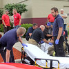 Rod Rose The Lebanon Reporter<br /> STABBING AT RESTAURANT: Firefighters and EMTs treat the victim of a stabbing who came to the rear of a Kentucky Fried Restaurant in Lebanon Wednesday morning.