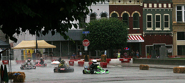 Rod Rose The Lebanon Reporter<br /> LAPS IN THE RAIN: Four go karters blast onto Meridian Street in front of the Boone County Courthouse during a heat race Saturday for the Mel Kenyon Classic in downtown Lebanon.