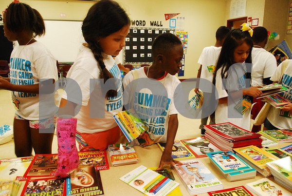 (Junior League Summer Reading Campers selecting their books at the bookstore/Hakim Zakaria)