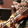 BEN GARVER — THE BERKSHIRE EAGLE<br /> Gerdlie Jeanlouis, 15,  plays the violin as Kids 4 Harmony rehearse at Morningside Community School, Wednesday, July 10, 2019. <br /> On July 15, they'll play the Berkshire Children and Families gala, which will launch with a rebranding. The next day, eight students will be traveling to California for the Yola National Festival; one of those students, Gerdlie Jeanlouis, 15,  has been selected as one of 17 to participate in the inaugural Yola Institute, travel to Scotland with the Los Angeles Philharmonic, and be mentored by an LA Philharmonic musician for the upcoming school year.