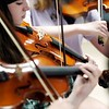 BEN GARVER — THE BERKSHIRE EAGLE<br /> Grace Burdick, 12,  plays violin as Kids 4 Harmony rehearse at Morningside Community School, Wednesday, July 10, 2019. <br /> On July 15, they'll play the Berkshire Children and Families gala, which will launch with a rebranding. The next day, eight students will be traveling to California for the Yola National Festival; one of those students, Gerdlie Jeanlouis, 15,  has been selected as one of 17 to participate in the inaugural Yola Institute, travel to Scotland with the Los Angeles Philharmonic, and be mentored by an LA Philharmonic musician for the upcoming school year.