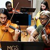 BEN GARVER — THE BERKSHIRE EAGLE<br /> Leila Paredes, 15, and Gerdlie Jeanlouis, 15,  play the violin as Kids 4 Harmony rehearse at Morningside Community School, Wednesday, July 10, 2019. <br /> On July 15, they'll play the Berkshire Children and Families gala, which will launch with a rebranding. The next day, eight students will be traveling to California for the Yola National Festival; one of those students, Gerdlie Jeanlouis, 15,  has been selected as one of 17 to participate in the inaugural Yola Institute, travel to Scotland with the Los Angeles Philharmonic, and be mentored by an LA Philharmonic musician for the upcoming school year.