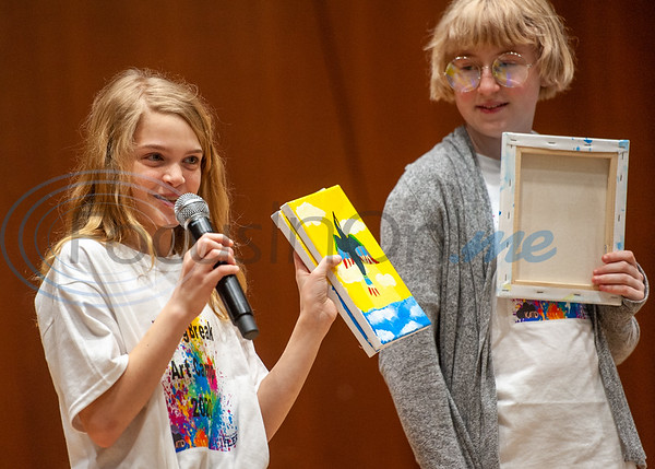 Camper Miley Horsely showcases her canvas painting as fellow camper Rey Bowles looks on during Spring Break Art Camp hosted by KATD (Kids Aspiring To Dream), a talent & performing arts organization, Tuesday, March 10, 2020, in the University Center auditorium at UT Tyler in Tyler.