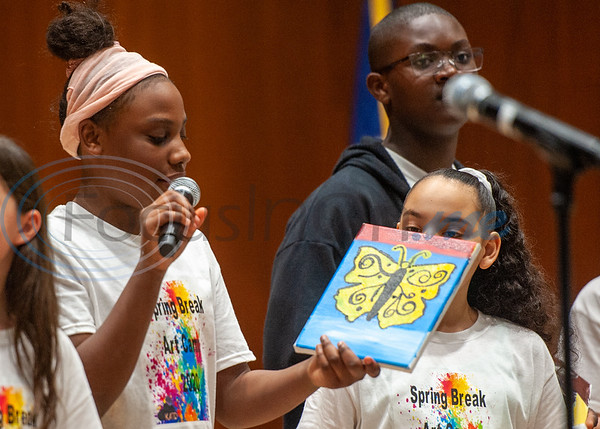 Campers look on as Sydnee Tate showcases her painting of a butterfly during Spring Break Art Camp hosted by KATD (Kids Aspiring To Dream), a talent & performing arts organization, Tuesday, March 10, 2020, in the University Center auditorium at UT Tyler in Tyler.