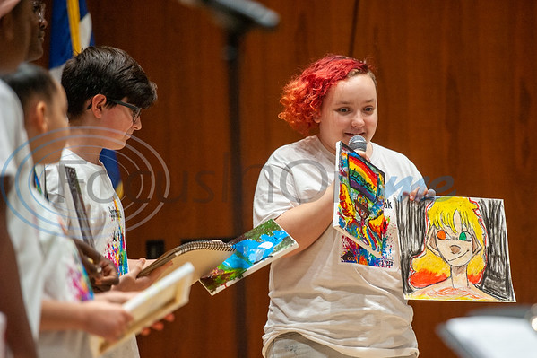 Campers look on as Ainsley Brinton (right) showcases her works of art during Spring Break Art Camp hosted by KATD (Kids Aspiring To Dream), a talent & performing arts organization, Tuesday, March 10, 2020, in the University Center auditorium at UT Tyler in Tyler.