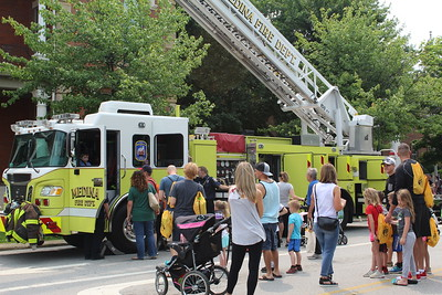 A popular attraction Saturday at Kids Day of Safety and Play on Public Square in Medina was getting to go inside a Medina Fire Department firetruck. LYDIA MAINZER / GAZETTE