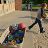 Mason Kish, 5 1/2, runs to the playground with a ball to play before starting the first day of kindergarten at Kohl Elementary School on Friday. Curtis' father Philip looks on in the background.<br />  August 17, 2012<br /> staff photo/ David R. Jennings