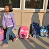 Liliana Escalante, 5, smiles after dropping off her back pack before the start of the first day of kindergarten at Kohl Elementary School on Friday. Curtis' father Philip looks on in the background.<br />  August 17, 2012<br /> staff photo/ David R. Jennings
