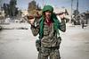 Members of YPG patrol Kobane neighbourhood after expulse ISIS combatant, Kobane, Syria, March 6, 2015. (Austral Foto/Alexandro Auler)