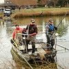 Aquatic Biologist for Colorado Parks and Wildlife Ben Swigle, left, Paul Hladick, and Steven Mattocks electroshock koi fish at Thunderbird Lake in Admiral Arleigh A. Burke Park where Colorado Parks and Wildlife staff attempt to remove a population of koi fish in Boulder on Monday Nov. 19, 2012. DAILY CAMERA/ JESSICA CUNEO.