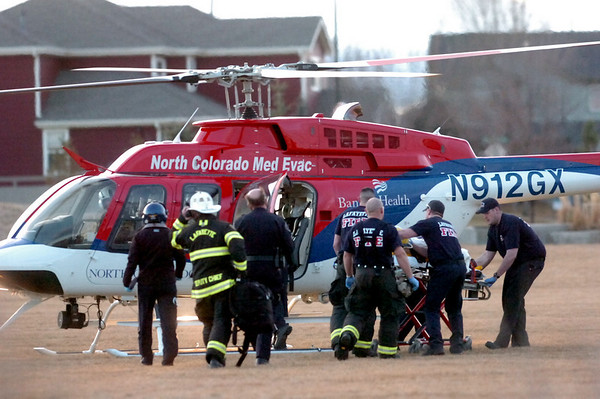 A man is wheeled away to a waiting helicopter after reports of a shooting on the 2800 block of Whitetail Circle in Lafayette on Tuesday, Feb. 23, 2011. (Paul Aiken / DAILY CAMERA)