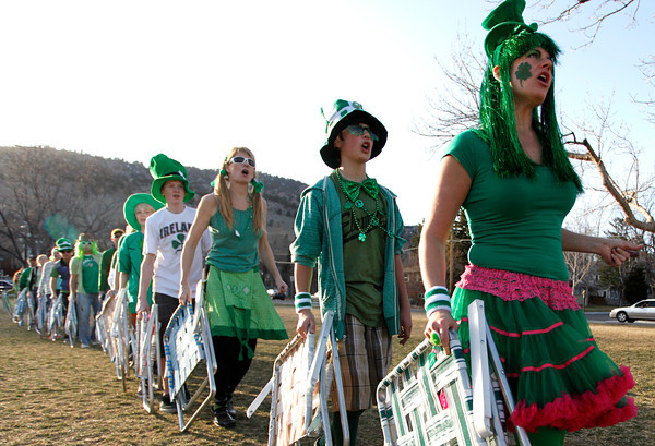Nancy Casella, right, and Foster Greer, 13, leads the lawn chair brigade during practice before  St. Patrick day, Sunday, March, 4, 2012. Boulder.<br /> Photo by Derek Broussard